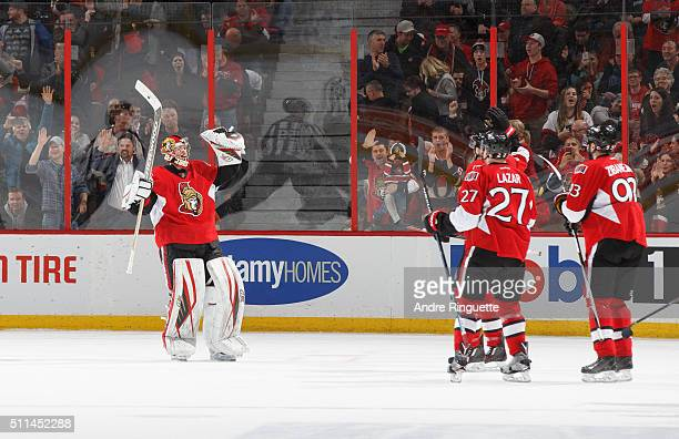 Craig Anderson of the Ottawa Senators celebrates his shootout win over the Detroit Red Wings with teammates Curtis Lazar and Mika Zibanejad at...