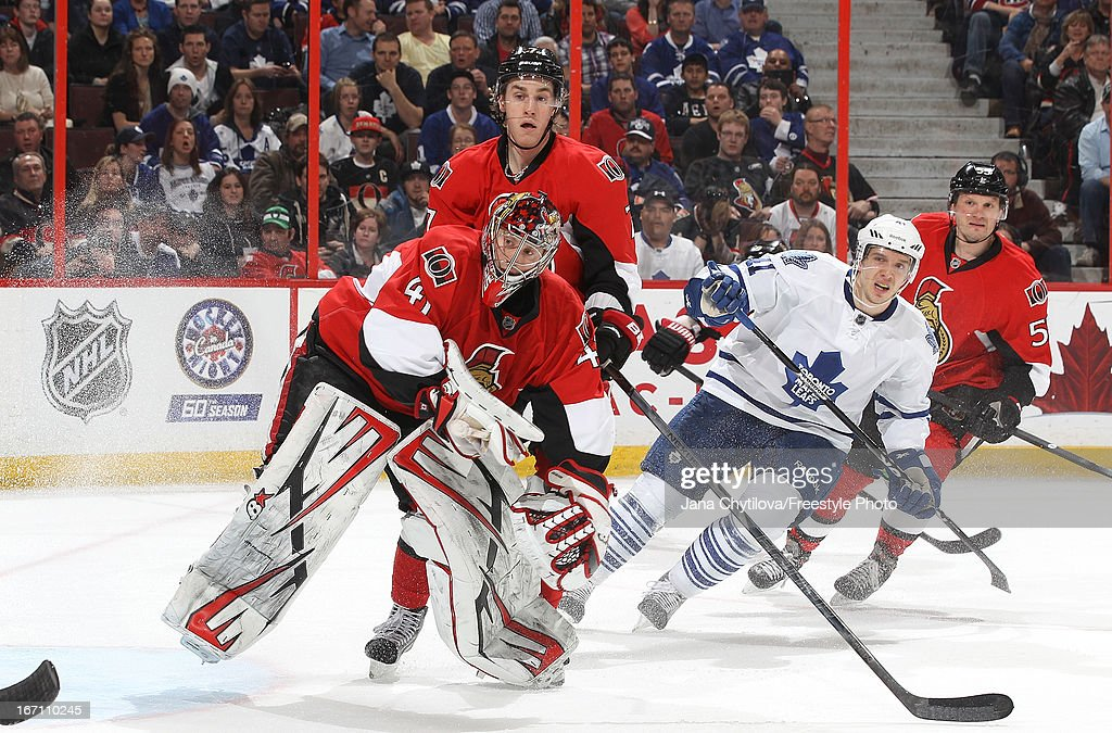 <a gi-track='captionPersonalityLinkClicked' href=/galleries/search?phrase=Craig+Anderson&family=editorial&specificpeople=211238 ng-click='$event.stopPropagation()'>Craig Anderson</a> #41 of the Ottawa Senators comes out of his crease to play the puck as teammates <a gi-track='captionPersonalityLinkClicked' href=/galleries/search?phrase=Kyle+Turris&family=editorial&specificpeople=4251834 ng-click='$event.stopPropagation()'>Kyle Turris</a> #7 and <a gi-track='captionPersonalityLinkClicked' href=/galleries/search?phrase=Sergei+Gonchar&family=editorial&specificpeople=202470 ng-click='$event.stopPropagation()'>Sergei Gonchar</a> #55 look on and <a gi-track='captionPersonalityLinkClicked' href=/galleries/search?phrase=Nikolai+Kulemin&family=editorial&specificpeople=537949 ng-click='$event.stopPropagation()'>Nikolai Kulemin</a> #41 of the Toronto Maple Leafs skates during an NHL game, at Scotiabank Place, on April 20, 2013 in Ottawa, Ontario, Canada.