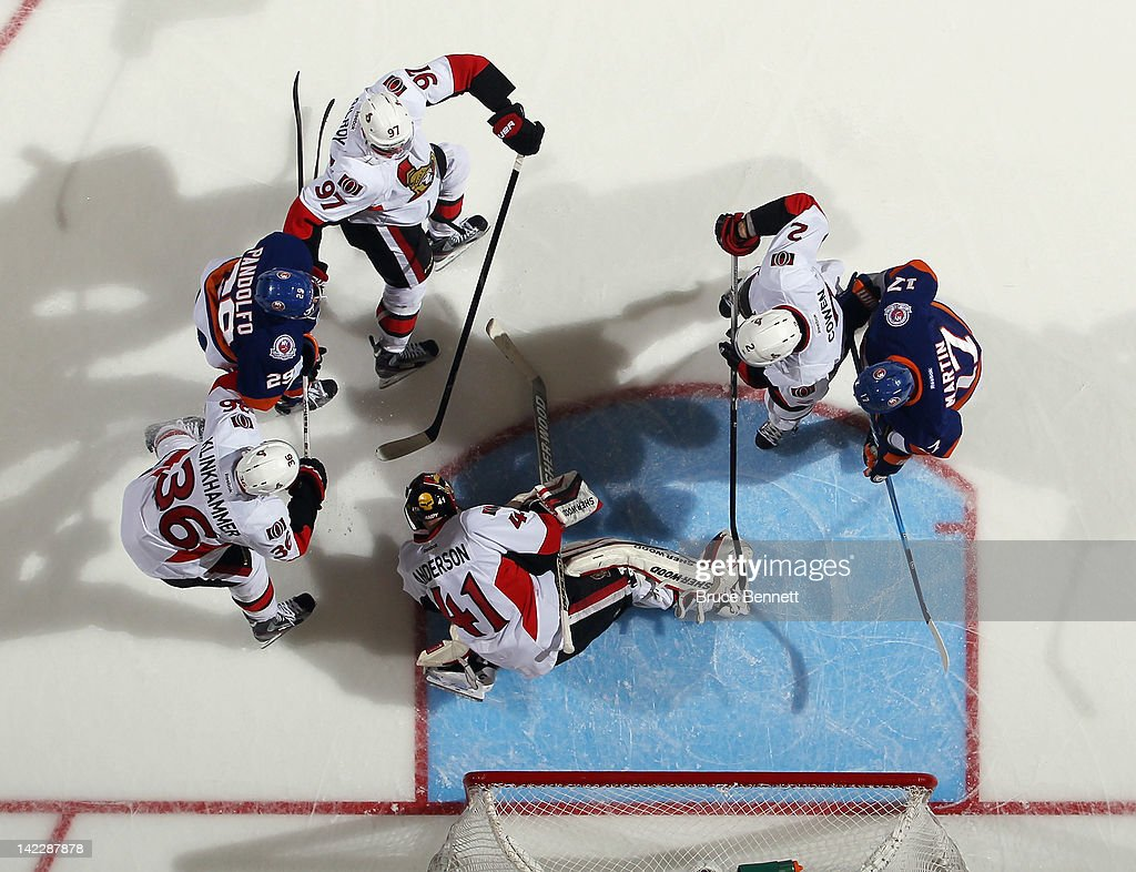 <a gi-track='captionPersonalityLinkClicked' href=/galleries/search?phrase=Craig+Anderson&family=editorial&specificpeople=211238 ng-click='$event.stopPropagation()'>Craig Anderson</a> #41 of the Ottawa Senators covers the puck in his game against the New York Islanders at the Nassau Veterans Memorial Coliseum on April 1, 2012 in Uniondale, New York. The Senators defeated the Islanders 5-1 to clinch a playoff berth.