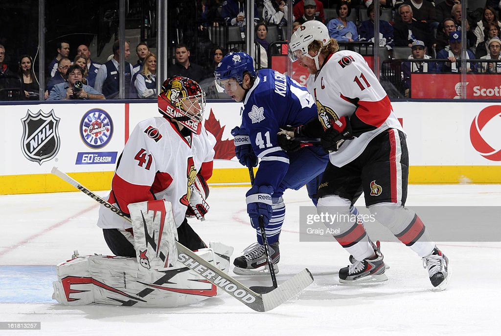 Craig Anderson #41 of the Ottawa Senators defends the goal as teammate Daniel Alfredsson #11 battles with Nikolai Kulemin #41 of of the Toronto Maple Leafs during NHL game action February 16, 2013 at the Air Canada Centre in Toronto, Ontario, Canada.