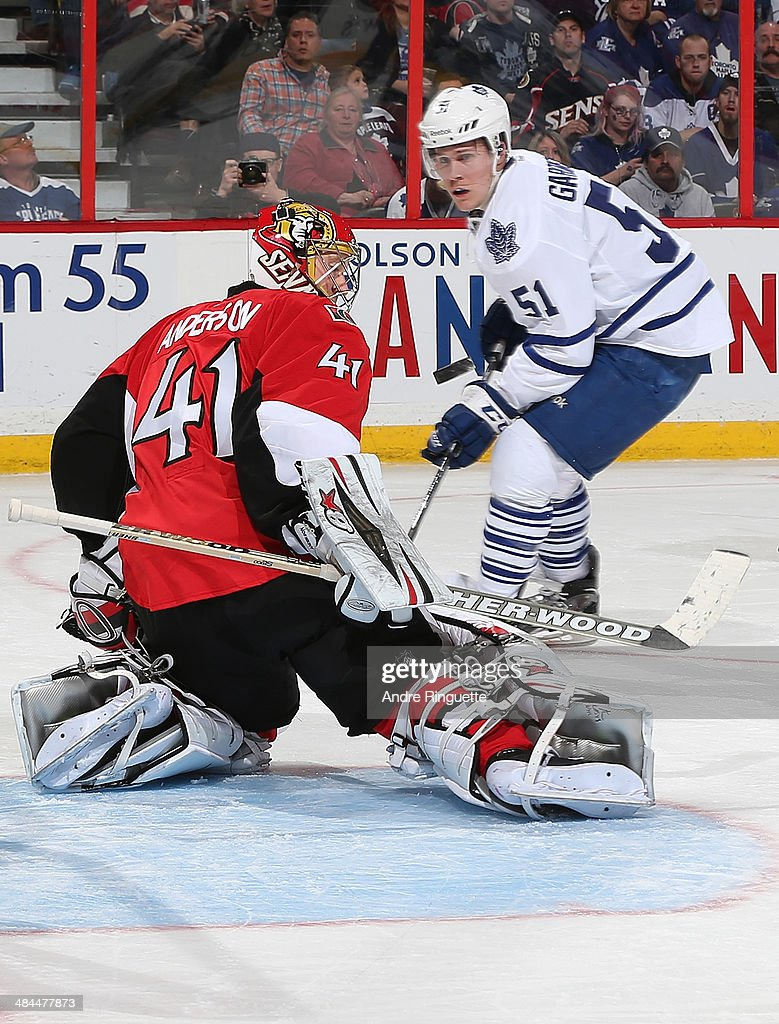 Craig Anderson #41 of the Ottawa Senators deflects the puck away on a save against Jake Gardiner #51 of the Toronto Maple Leafs at Canadian Tire Centre on April 12, 2014 in Ottawa, Ontario, Canada.