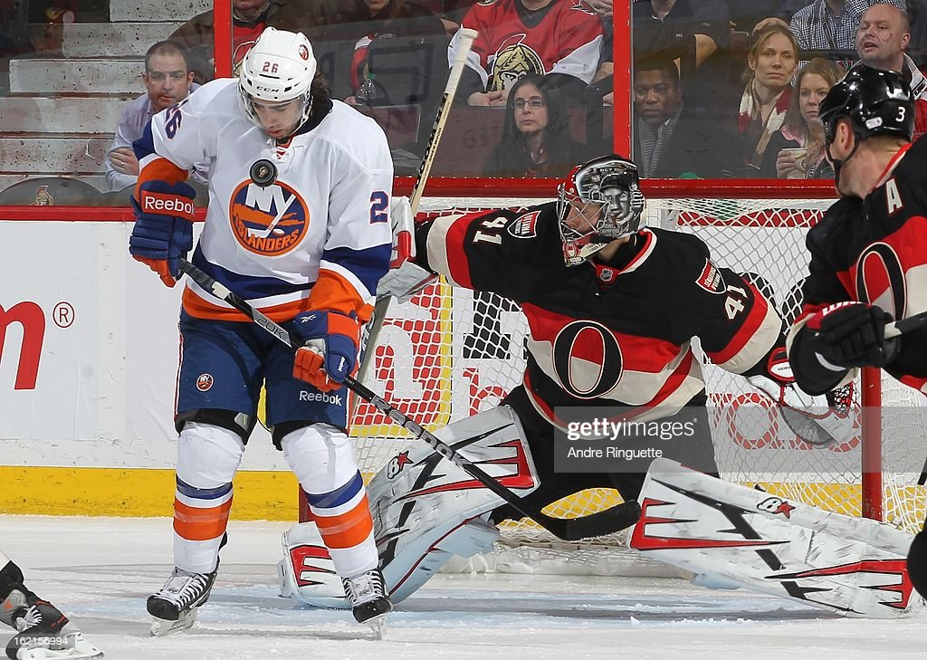 Craig Anderson #41 of the Ottawa Senators gets ready to make a save as the puck deflects off Matt Moulson #26 of the New York Islanders on February 19, 2013 at Scotiabank Place in Ottawa, Ontario, Canada.