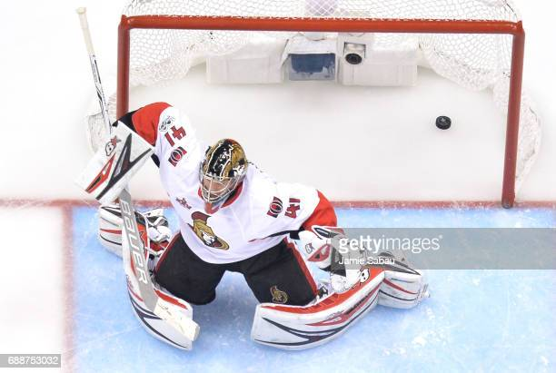 Craig Anderson of the Ottawa Senators gives up the game winning goal to Chris Kunitz of the Pittsburgh Penguins in the second oevertime in Game Seven...
