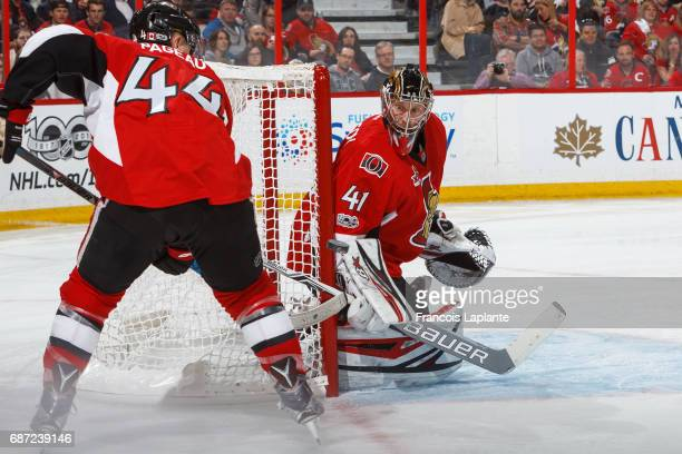 Craig Anderson of the Ottawa Senators guards his net as JeanGabriel Pageau defends against the Pittsburgh Penguins in Game Four of the Eastern...