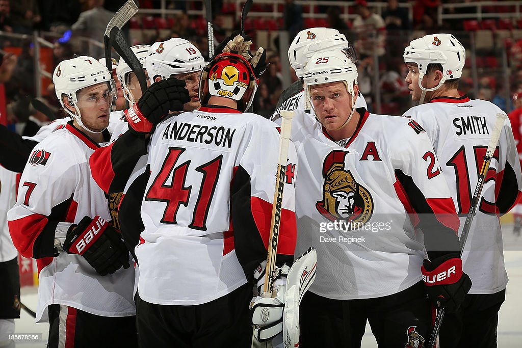 <a gi-track='captionPersonalityLinkClicked' href=/galleries/search?phrase=Craig+Anderson&family=editorial&specificpeople=211238 ng-click='$event.stopPropagation()'>Craig Anderson</a> #41 of the Ottawa Senators is congratulated by Chris Neil #25, <a gi-track='captionPersonalityLinkClicked' href=/galleries/search?phrase=Kyle+Turris&family=editorial&specificpeople=4251834 ng-click='$event.stopPropagation()'>Kyle Turris</a> #7, <a gi-track='captionPersonalityLinkClicked' href=/galleries/search?phrase=Jason+Spezza&family=editorial&specificpeople=202023 ng-click='$event.stopPropagation()'>Jason Spezza</a> #19 and the rest of his teammates after defeating the Detroit Red Wings 6-1during an NHL game at Joe Louis Arena on October 23, 2013 in Detroit, Michigan.