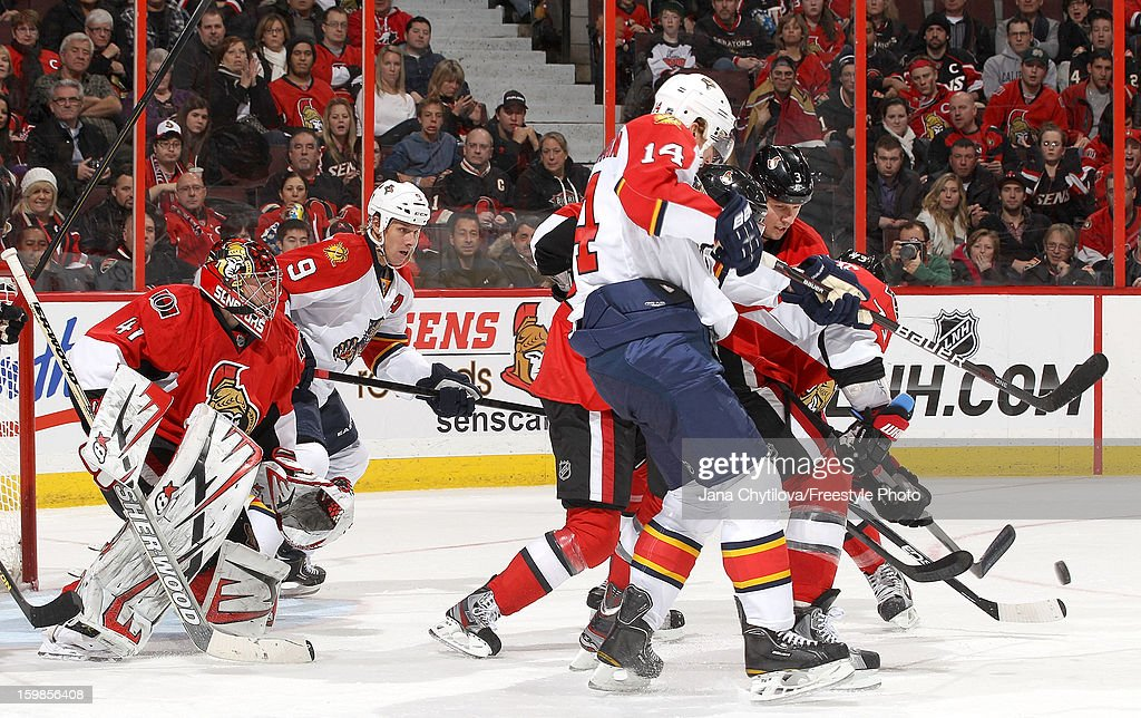 Craig Anderson #41 of the Ottawa Senators keeps his eye on the puck through a scramble of players during an NHL game against the Florida Panthers at Scotiabank Place on January 21, 2013 in Ottawa, Ontario, Canada.