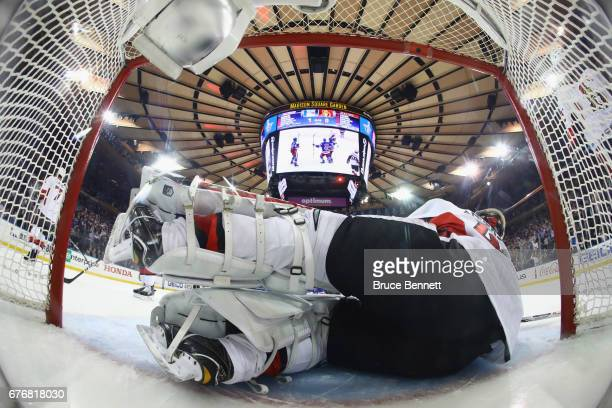 Craig Anderson of the Ottawa Senators lies in the net following a first period goal by Michael Grabner of the New York Rangers in Game Three of the...
