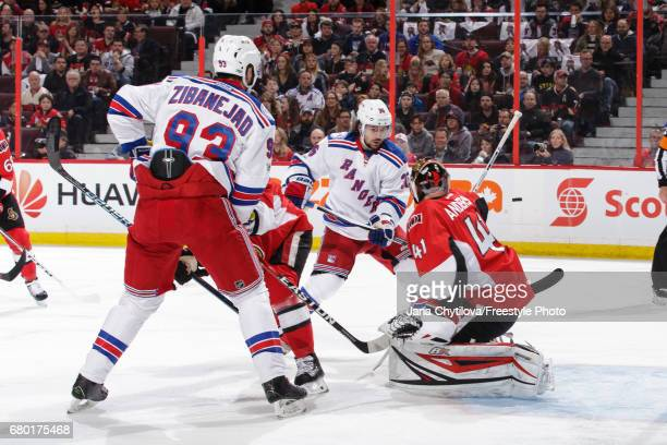 Craig Anderson of the Ottawa Senators makes a blocker save against Mats Zuccarello and Mika Zibanejad of the New York Rangers in Game Five of the...