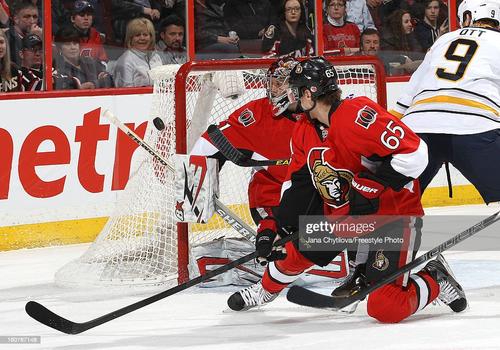 <a gi-track='captionPersonalityLinkClicked' href=/galleries/search?phrase=Craig+Anderson&family=editorial&specificpeople=211238 ng-click='$event.stopPropagation()'>Craig Anderson</a> #41 of the Ottawa Senators makes a blocker save as teammate <a gi-track='captionPersonalityLinkClicked' href=/galleries/search?phrase=Erik+Karlsson&family=editorial&specificpeople=5370939 ng-click='$event.stopPropagation()'>Erik Karlsson</a> #65 looks on, during an NHL game against the Buffalo Sabres at Scotiabank Place on February 5, 2013 in Ottawa, Ontario, Canada.