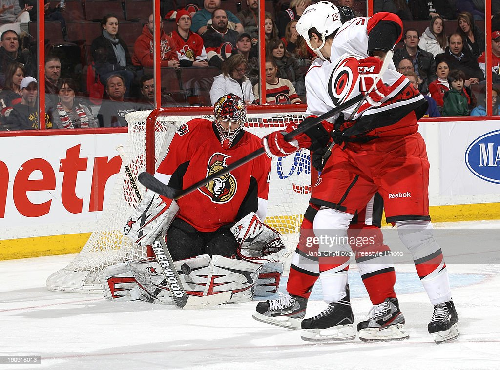 <a gi-track='captionPersonalityLinkClicked' href=/galleries/search?phrase=Craig+Anderson&family=editorial&specificpeople=211238 ng-click='$event.stopPropagation()'>Craig Anderson</a> #41 of the Ottawa Senators makes a butterfly save as Tim Wallace #29 of the Carolina Hurricanes looks for the rebound, during an NHL game at Scotiabank Place on February 7, 2013 in Ottawa, Ontario, Canada.