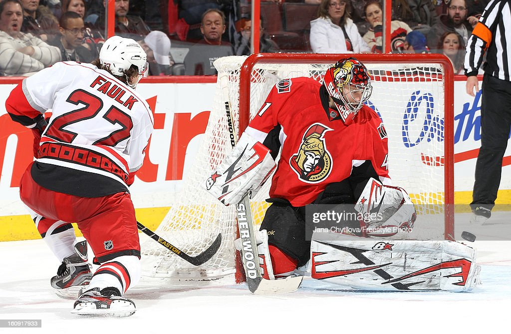 <a gi-track='captionPersonalityLinkClicked' href=/galleries/search?phrase=Craig+Anderson&family=editorial&specificpeople=211238 ng-click='$event.stopPropagation()'>Craig Anderson</a> #41 of the Ottawa Senators makes a pad save against Justin Faulk #27 of the Carolina Hurricanes during an NHL game at Scotiabank Place on February 7, 2013 in Ottawa, Ontario, Canada.