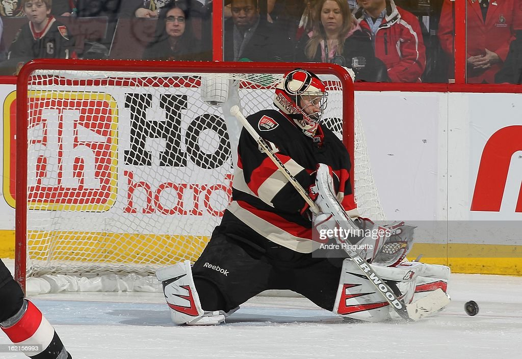 <a gi-track='captionPersonalityLinkClicked' href=/galleries/search?phrase=Craig+Anderson&family=editorial&specificpeople=211238 ng-click='$event.stopPropagation()'>Craig Anderson</a> #41 of the Ottawa Senators makes a pad save against the New York Islanders on February 19, 2013 at Scotiabank Place in Ottawa, Ontario, Canada.