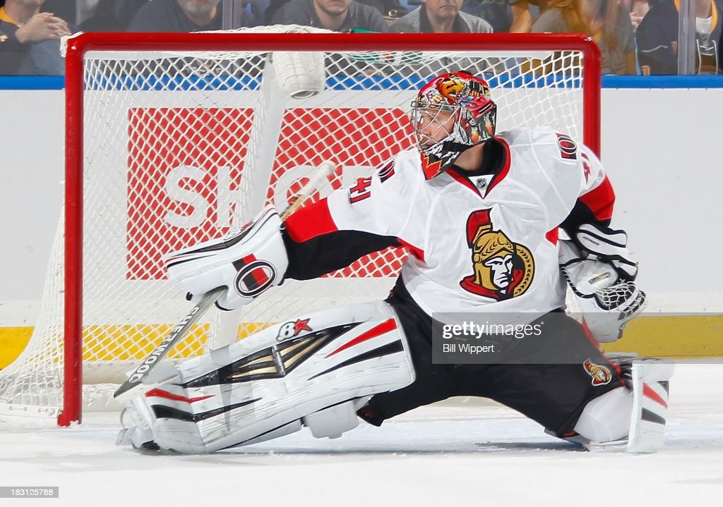 <a gi-track='captionPersonalityLinkClicked' href=/galleries/search?phrase=Craig+Anderson&family=editorial&specificpeople=211238 ng-click='$event.stopPropagation()'>Craig Anderson</a> #41 of the Ottawa Senators makes a pad save against the Buffalo Sabres on October 4, 2013 at the First Niagara Center in Buffalo, New York. Ottawa defeated Buffalo, 1-0.