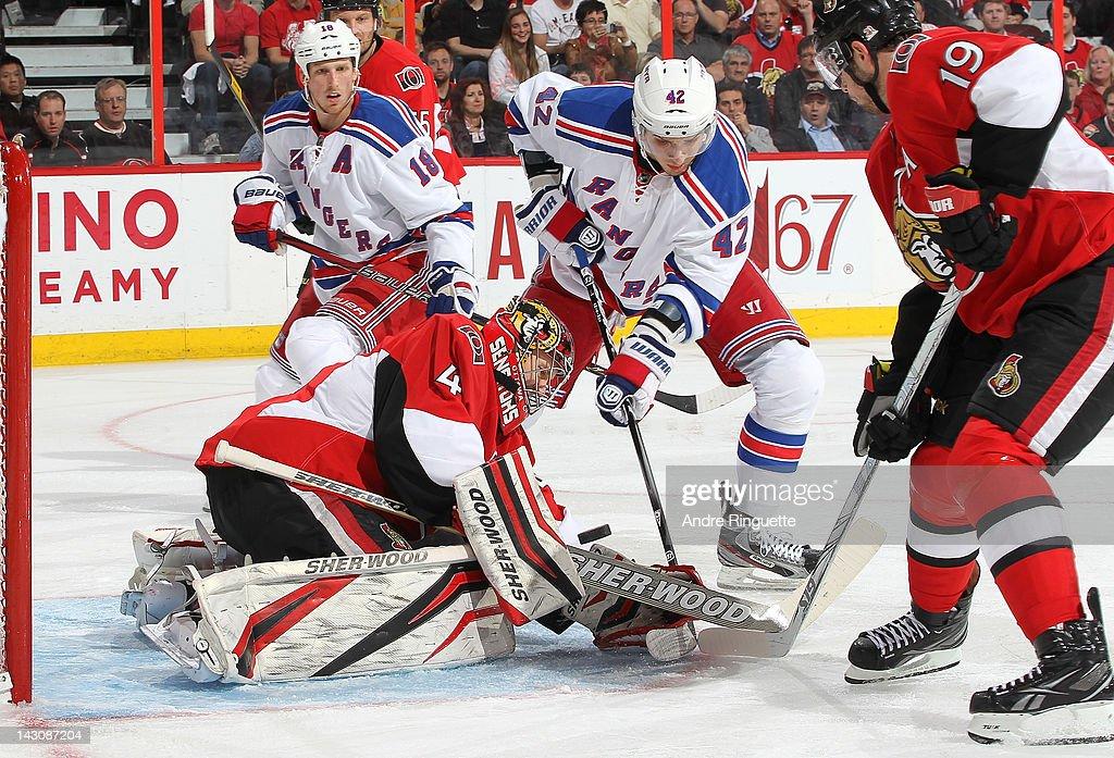Craig Anderson of the Ottawa Senators makes a save against Artem Anisimov of the New York Rangers as Jason Spezza of the Ottawa Senators and Marc...