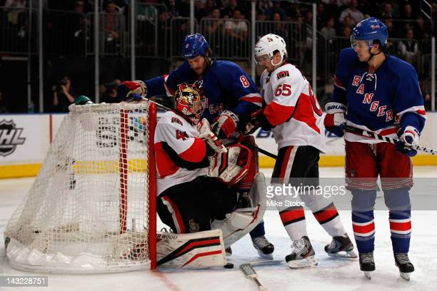 Craig Anderson of the Ottawa Senators makes a save against Brandon Prust of the New York Rangers in Game Five of the Eastern Conference Quarterfinals...