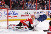 Craig Anderson of the Ottawa Senators makes a save against Carl Gunnarsson of the Toronto Maple Leafs during an NHL game at Canadian Tire Centre on...
