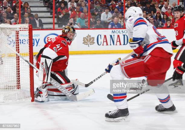 Craig Anderson of the Ottawa Senators makes a save against Mika Zibanejad of the New York Rangers in Game Two of the Eastern Conference Second Round...