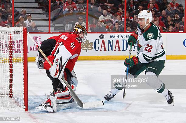 Craig Anderson of the Ottawa Senators makes a save against Nino Niederreiter of the Minnesota Wild on a breakaway chance at Canadian Tire Centre on...