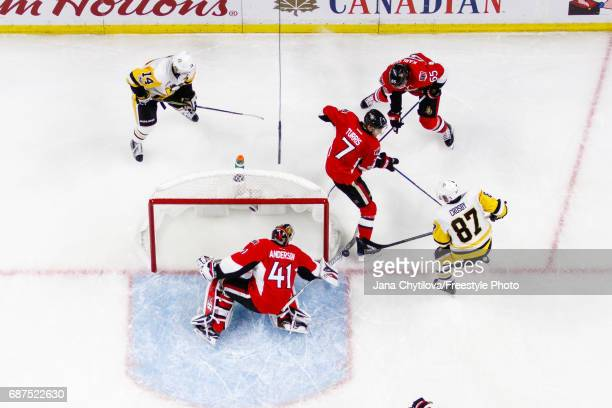 Craig Anderson of the Ottawa Senators makes a save against Sidney Crosby of the Pittsburgh Penguins as Kyle Turris and Erik Karlsson of the Senators...