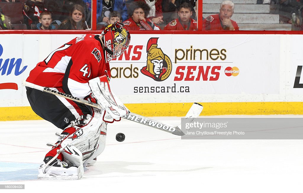 <a gi-track='captionPersonalityLinkClicked' href=/galleries/search?phrase=Craig+Anderson&family=editorial&specificpeople=211238 ng-click='$event.stopPropagation()'>Craig Anderson</a> #41 of the Ottawa Senators makes a save against the Pittsburgh Penguins during an NHL game at Scotiabank Place on January 27, 2013 in Ottawa, Ontario, Canada.