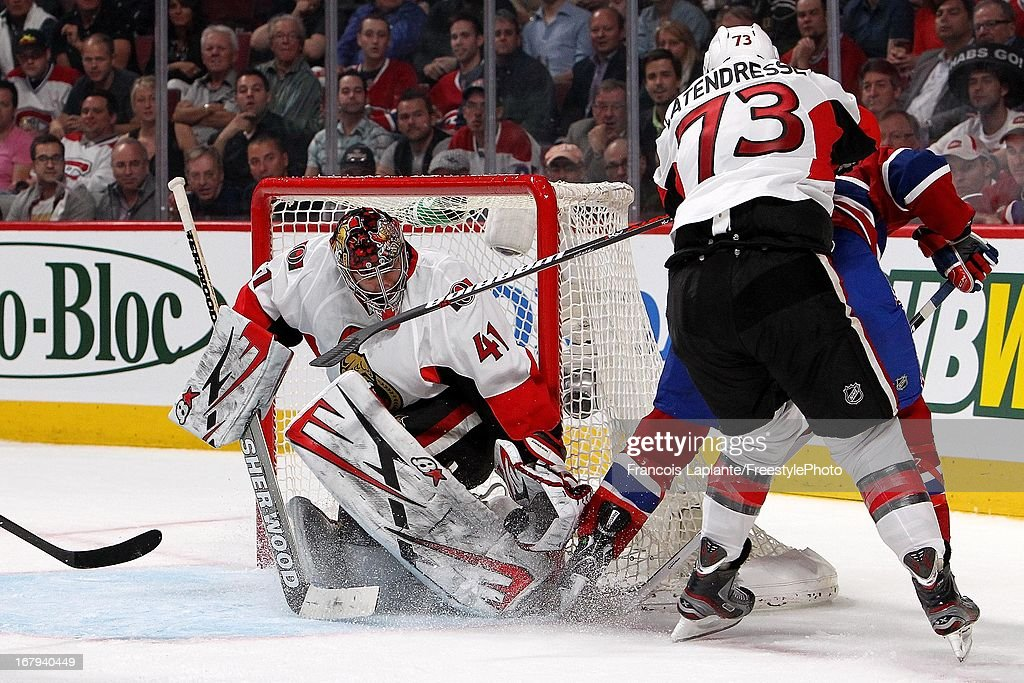 Craig Anderson #41 of the Ottawa Senators makes a save as <a gi-track='captionPersonalityLinkClicked' href=/galleries/search?phrase=Guillaume+Latendresse&family=editorial&specificpeople=848999 ng-click='$event.stopPropagation()'>Guillaume Latendresse</a> #73 defends against <a gi-track='captionPersonalityLinkClicked' href=/galleries/search?phrase=Brandon+Prust&family=editorial&specificpeople=2221796 ng-click='$event.stopPropagation()'>Brandon Prust</a> #8 of the Montreal Canadiens in Game One of the Eastern Conference Quarterfinal during the 2013 NHL Stanley Cup Playoffs at the Bell Centre on May 2, 2013 in Montreal, Quebec, Canada.