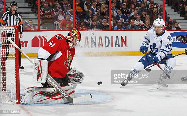 Craig Anderson of the Ottawa Senators makes a save as Michael Grabner of the Toronto Maple Leafs skates in close to the crease for the rebound at...