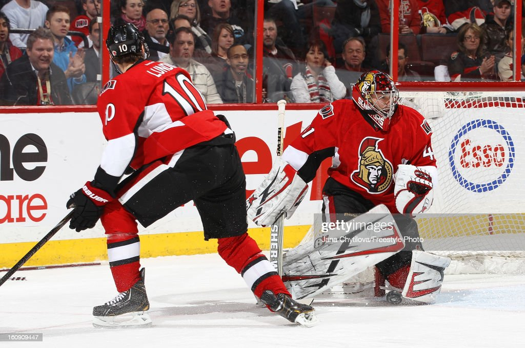 Craig Anderson #41 of the Ottawa Senators makes a save as team mate Mike Lundin #10 looks on during an NHL game against the Carolina Hurricanes at Scotiabank Place on February 7, 2013 in Ottawa, Ontario, Canada.