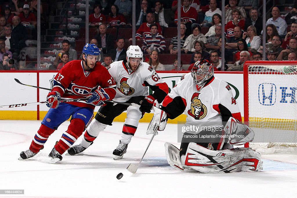 <a gi-track='captionPersonalityLinkClicked' href=/galleries/search?phrase=Craig+Anderson&family=editorial&specificpeople=211238 ng-click='$event.stopPropagation()'>Craig Anderson</a> #41 of the Ottawa Senators makes a save as teammate <a gi-track='captionPersonalityLinkClicked' href=/galleries/search?phrase=Cory+Conacher&family=editorial&specificpeople=8312407 ng-click='$event.stopPropagation()'>Cory Conacher</a> #89 defends against Gabriel Dumont #37 of the Montreal Canadiens in Game Five of the Eastern Conference Quarterfinals during the 2013 NHL Stanley Cup Playoffs at the Bell Centre on May 9, 2013 in Montreal, Quebec, Canada.