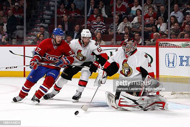 Craig Anderson of the Ottawa Senators makes a save as teammate Cory Conacher defends against Gabriel Dumont of the Montreal Canadiens in Game Five of...