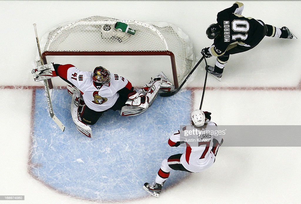 <a gi-track='captionPersonalityLinkClicked' href=/galleries/search?phrase=Craig+Anderson&family=editorial&specificpeople=211238 ng-click='$event.stopPropagation()'>Craig Anderson</a> #41 of the Ottawa Senators makes a save on <a gi-track='captionPersonalityLinkClicked' href=/galleries/search?phrase=Brenden+Morrow&family=editorial&specificpeople=202256 ng-click='$event.stopPropagation()'>Brenden Morrow</a> #10 of the Pittsburgh Penguins in the first period in Game Two of the Eastern Conference Semifinals during the 2013 NHL Stanley Cup Playoffs at Consol Energy Center on May 17, 2013 in Pittsburgh, Pennsylvania. The Penguins defeated the Senators 4-3.