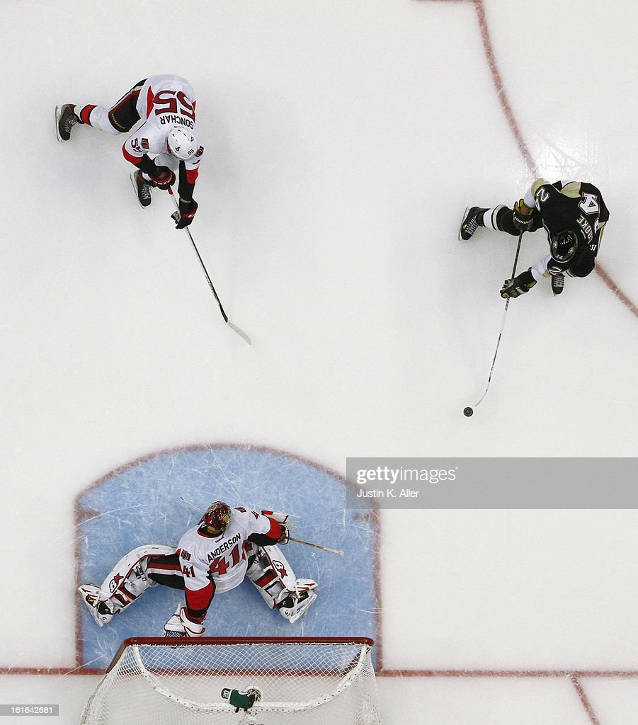 Craig Anderson #41 of the Ottawa Senators makes a save on Matt Cooke #24 of the Pittsburgh Penguins during the game at Consol Energy Center on February 13, 2013 in Pittsburgh, Pennsylvania. The Penguins won 4-2.