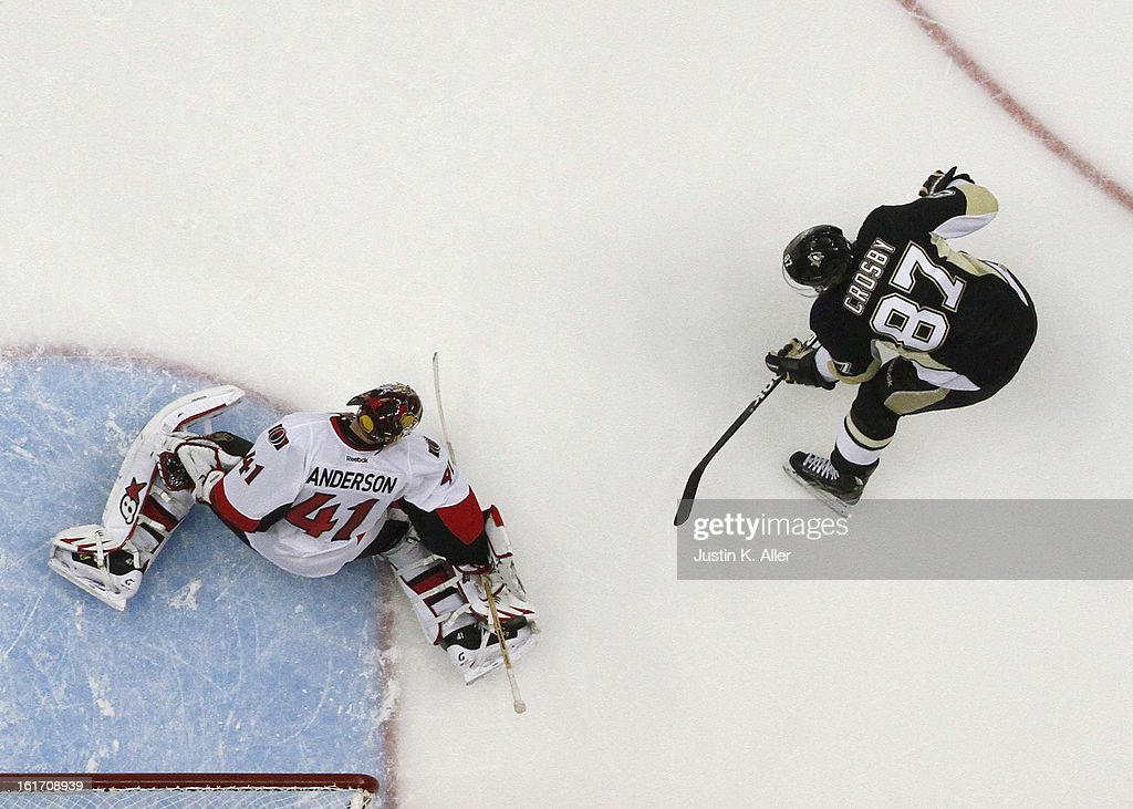 Craig Anderson #41 of the Ottawa Senators makes a save on Sidney Crosby #87 of the Pittsburgh Penguins at Consol Energy Center on February 13, 2013 in Pittsburgh, Pennsylvania.
