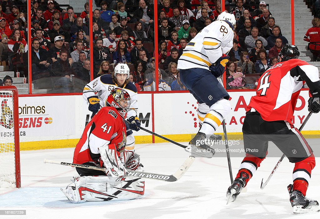 <a gi-track='captionPersonalityLinkClicked' href=/galleries/search?phrase=Craig+Anderson&family=editorial&specificpeople=211238 ng-click='$event.stopPropagation()'>Craig Anderson</a> #41 of the Ottawa Senators makes a save while Marcus Foligno #82 of the Buffalo Sabres jumps up as the shot is taken, during an NHL game at Scotiabank Place on February 12, 2013 in Ottawa, Ontario, Canada.