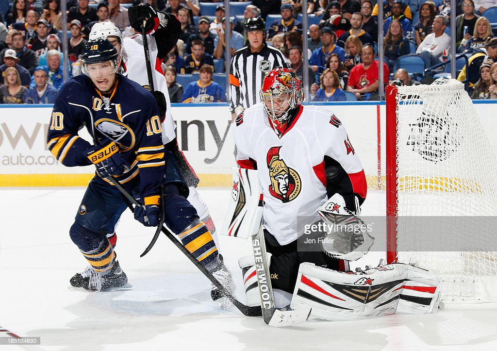 Craig Anderson #41 of the Ottawa Senators makes a second period save alongside Christian Ehrhoff #10 of the Buffalo Sabres at First Niagara Center on October 4, 2013 in Buffalo, New York.