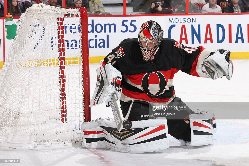 <a gi-track='captionPersonalityLinkClicked' href=/galleries/search?phrase=Craig+Anderson&family=editorial&specificpeople=211238 ng-click='$event.stopPropagation()'>Craig Anderson</a> #41 of the Ottawa Senators makes a stick save against the Washington Capitals during an NHL game at Canadian Tire Centre on December 30, 2013 in Ottawa, Ontario, Canada.