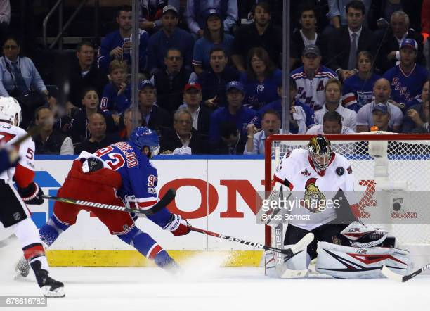 Craig Anderson of the Ottawa Senators makes the first period save on Mika Zibanejad of the New York Rangers in Game Three of the Eastern Conference...