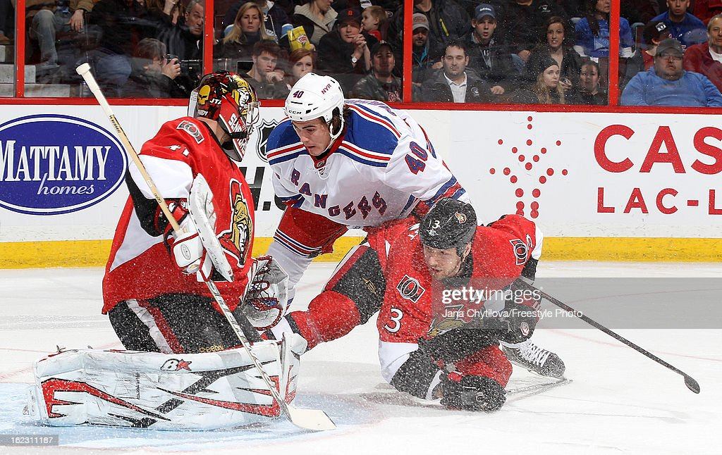 Craig Anderson #41 of the Ottawa Senators makes the save as Marc Methot #3 of the Ottawa Senators and Brandon Mashinter #40 of the New York Rangers watch for the rebound, during an NHL game at Scotiabank Place on February 21, 2013 in Ottawa, Ontario, Canada.