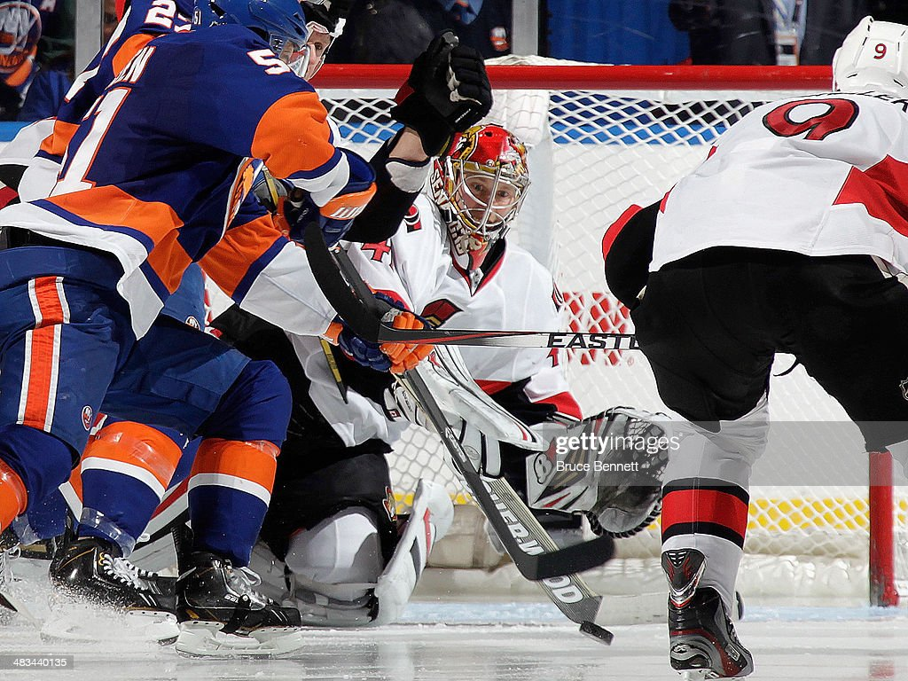 Craig Anderson #41 of the Ottawa Senators makes the third period save at the Nassau Veterans Memorial Coliseum on April 8, 2014 in Uniondale, New York. The Senators defeated the Islanders 4-1.