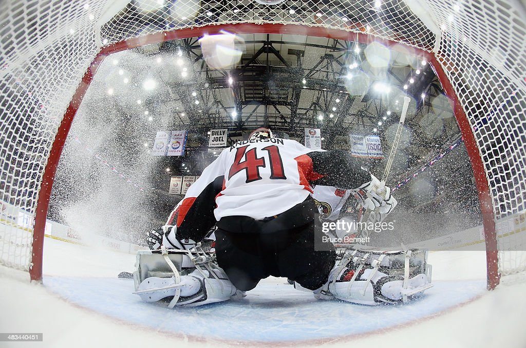 <a gi-track='captionPersonalityLinkClicked' href=/galleries/search?phrase=Craig+Anderson&family=editorial&specificpeople=211238 ng-click='$event.stopPropagation()'>Craig Anderson</a> #41 of the Ottawa Senators makes the third period stop against the New York Islanders at the Nassau Veterans Memorial Coliseum on April 8, 2014 in Uniondale, New York. The Senators defeated the Islanders 4-1.