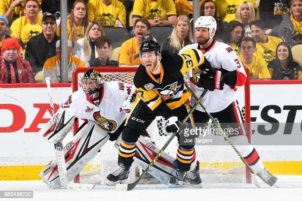 Craig Anderson of the Ottawa Senators protects the net against Carter Rowney of the Pittsburgh Penguins and Marc Methot of the Ottawa Senators in...