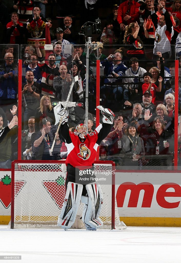 Craig Anderson #41 of the Ottawa Senators raises his arms to celebrate his shutout win over the Toronto Maple Leafs at Canadian Tire Centre on April 12, 2014 in Ottawa, Ontario, Canada.