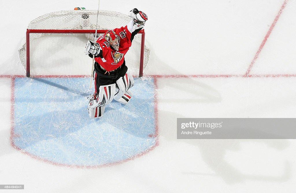 Craig Anderson #41 of the Ottawa Senators raises his arms to celebrate his shutout win over the Toronto Maple Leafs at Canadian Tire Centre on April 12, 2014 in Ottawa, Ontario, Canada.
