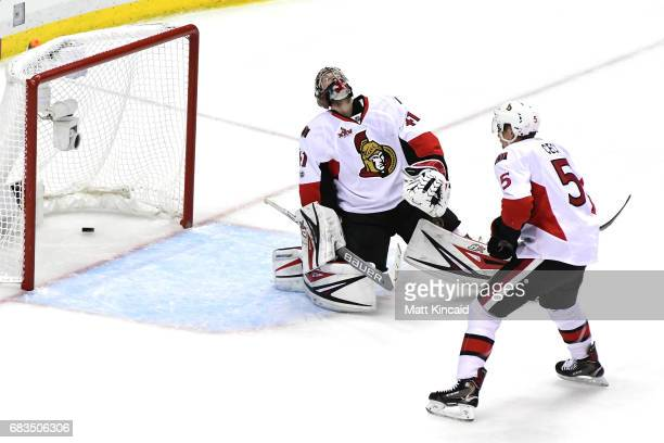 Craig Anderson of the Ottawa Senators reacts after giving up a goal to Phil Kessel of the Pittsburgh Penguins during the third period in Game Two of...