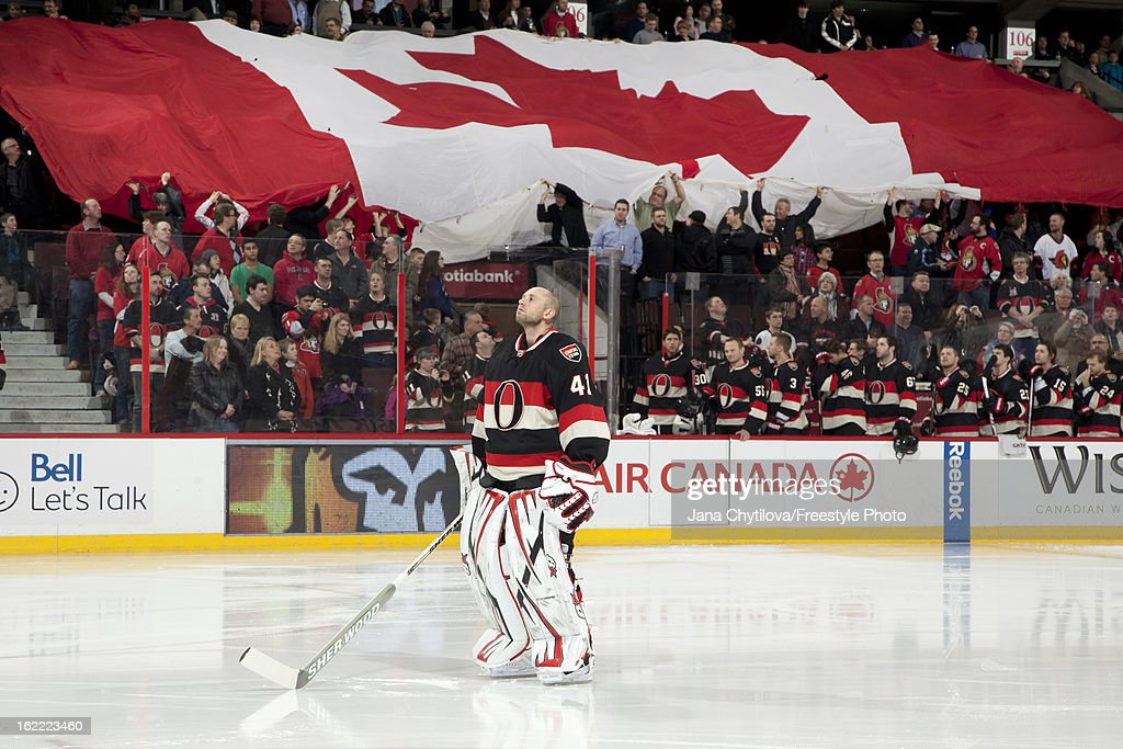 Craig Anderson #41 of the Ottawa Senators stands as a large Canada flag is passed amongst the fans, during the singing of the national anthems prior to an NHL game against the New York Islanders at Scotiabank Place on February 19, 2013 in Ottawa, Ontario, Canada.