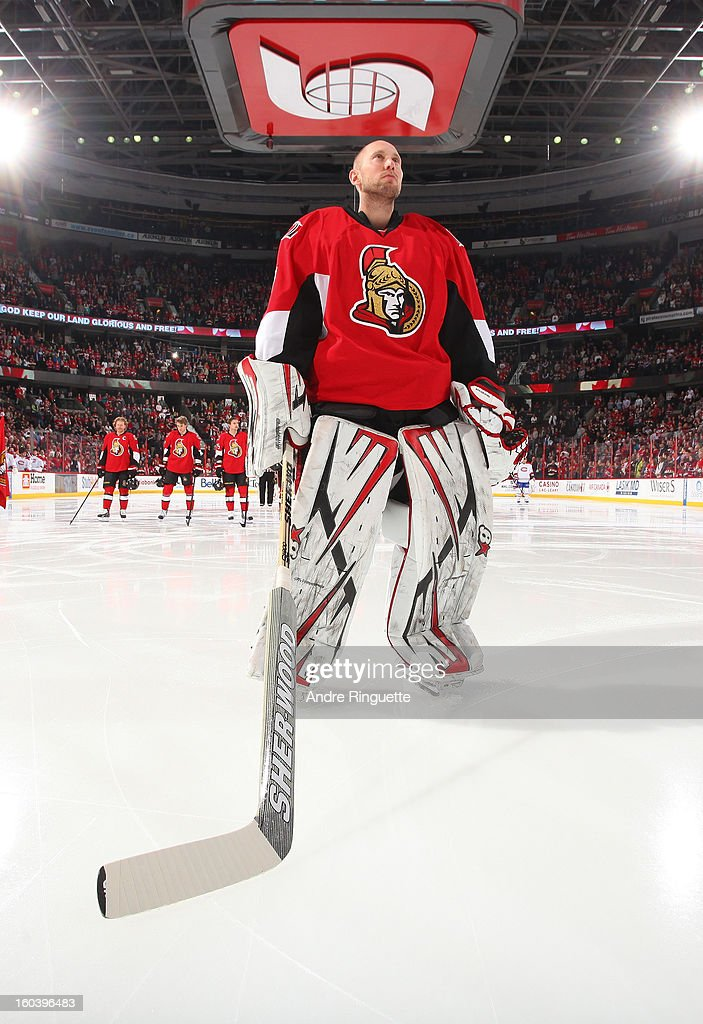 Craig Anderson #41 of the Ottawa Senators stands at attention during the singing of the national anthems prior to playing in his 300th career NHL game before a matchup against the Montreal Canadiens on January 30, 2013 at Scotiabank Place in Ottawa, Ontario, Canada.