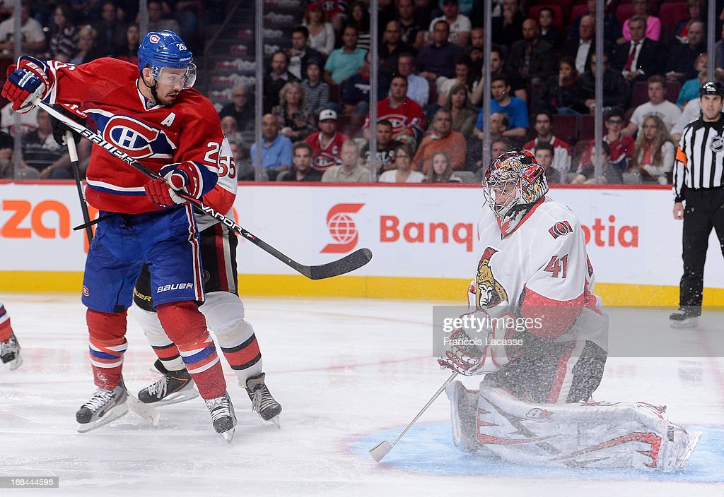 Craig Anderson #41 of the Ottawa Senators stops a shot deflected by <a gi-track='captionPersonalityLinkClicked' href=/galleries/search?phrase=Josh+Gorges&family=editorial&specificpeople=550446 ng-click='$event.stopPropagation()'>Josh Gorges</a> #26 of the Montreal Canadiens in Game Five of the Eastern Conference Quarterfinals during the 2013 NHL Stanley Cup Playoffs at the Bell Centre on May 9, 2013 in Montreal, Quebec, Canada.