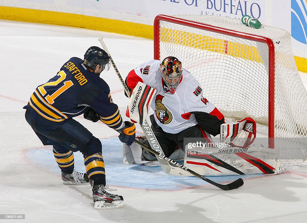 <a gi-track='captionPersonalityLinkClicked' href=/galleries/search?phrase=Craig+Anderson&family=editorial&specificpeople=211238 ng-click='$event.stopPropagation()'>Craig Anderson</a> #41 of the Ottawa Senators stops <a gi-track='captionPersonalityLinkClicked' href=/galleries/search?phrase=Drew+Stafford&family=editorial&specificpeople=220617 ng-click='$event.stopPropagation()'>Drew Stafford</a> #21 of the Buffalo Sabres in the shootout at First Niagara Center on December 31, 2011 in Buffalo, New York. Ottawa won 3-2 in a shootout.