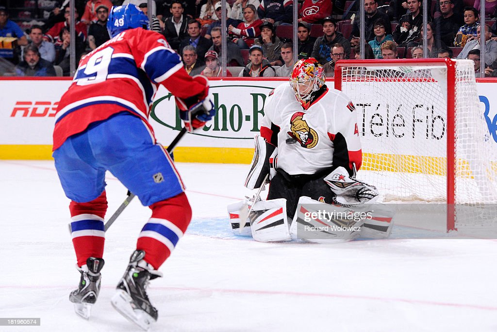 <a gi-track='captionPersonalityLinkClicked' href=/galleries/search?phrase=Craig+Anderson&family=editorial&specificpeople=211238 ng-click='$event.stopPropagation()'>Craig Anderson</a> #41 of the Ottawa Senators stops the puck on a shot by Michael Bournival #49 of the Montreal Canadiens during an NHL preseason game at the Bell Centre on September 26, 2013 in Montreal, Quebec, Canada.