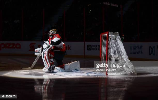 Craig Anderson of the Ottawa Senators stretches in his crease during player introductions prior to a game against the New York Islanders at Canadian...