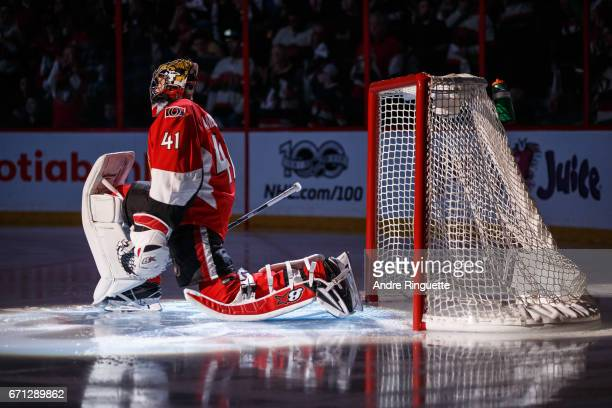 Craig Anderson of the Ottawa Senators stretches in his crease during player introductions prior to playing against the Boston Bruins in Game Five of...